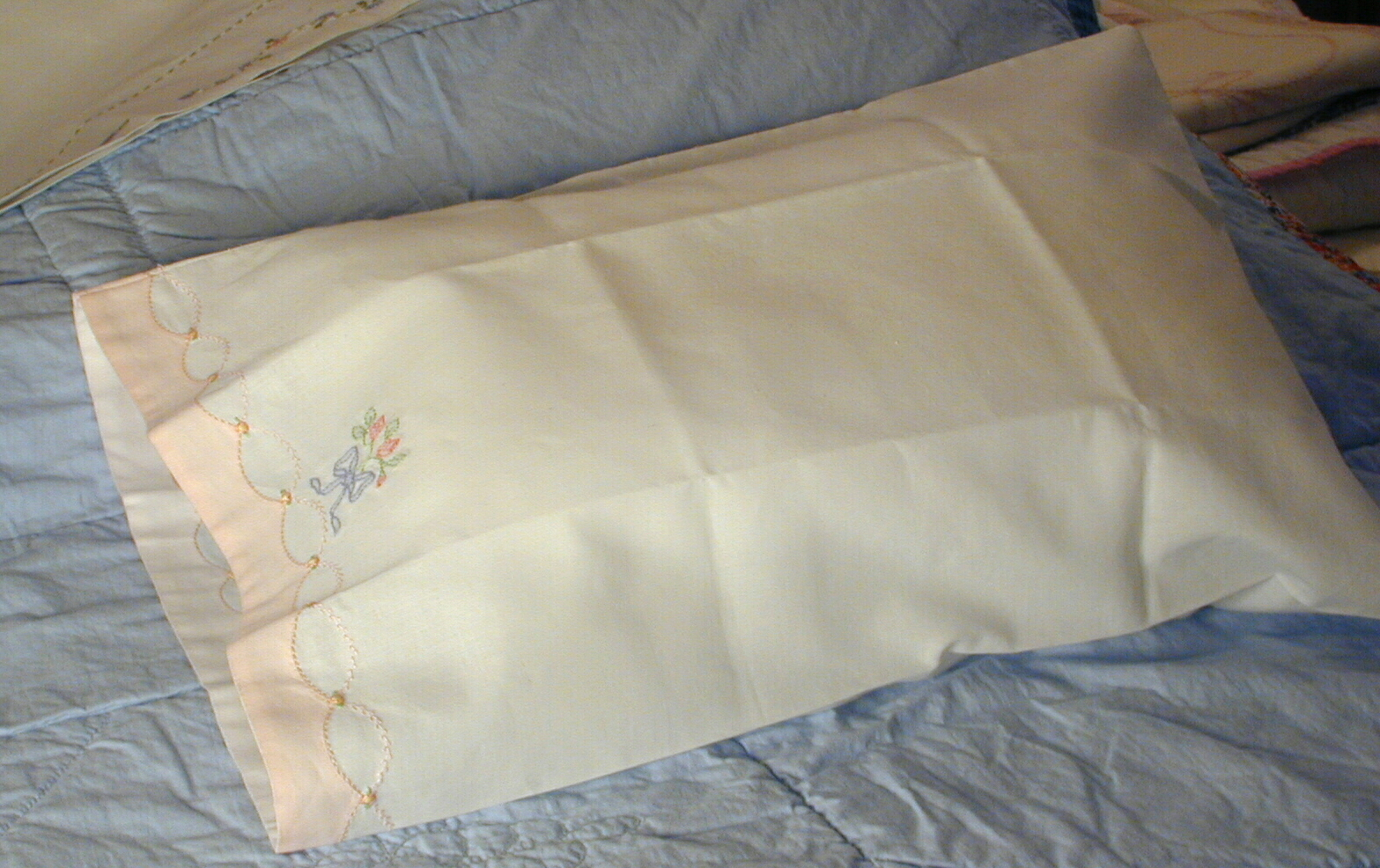 embroidery, featherstitching and Madeira applique hem, it looks