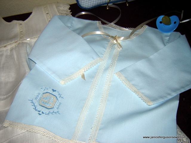 blue satin matinee jacket with machine embroidered Niva hemstitching design