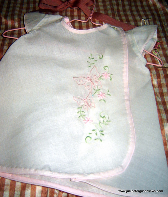 embroidered white linen dress bound in pink