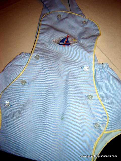sunsuit of blue baby cord, piped in yellow, embroidered with sailboat