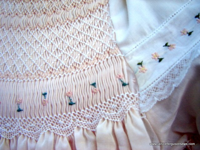 There should have been one more stitch joining the peach bodice to the white Swiss embroidery.