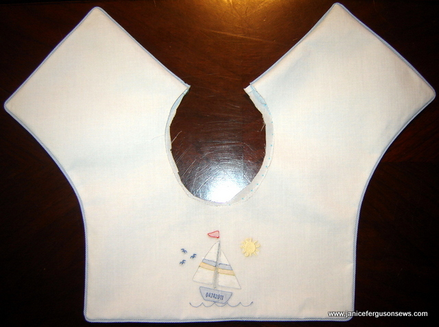 obert's collar features a sailboat design from Southern Stitches. The sun and birds were added to the design.