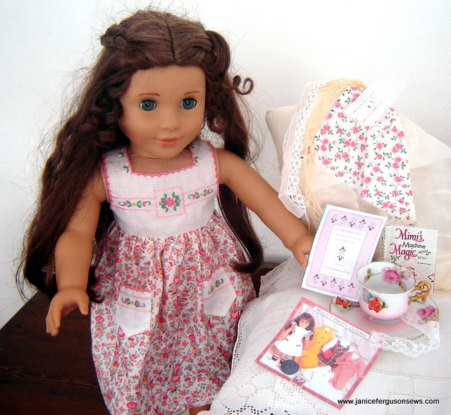 Marie Grace is getting ready to sew. She has Mildred Turner's book, Mimi's Machine Magic for reference, patterns to study, fabric and lace swatches to audition and her dress form ready for fitting. She'll soon need a cup of tea.