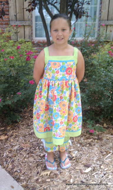"Kennedy is proudly wearing the sundress she made at her grandmother's (""Mimi"" Judy Day) sewing camp."