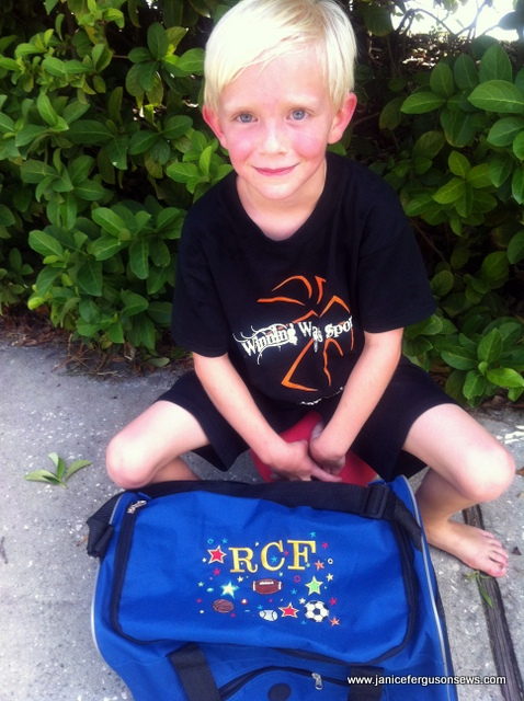 Robert and his bag, after swimming at camp in the hot sun