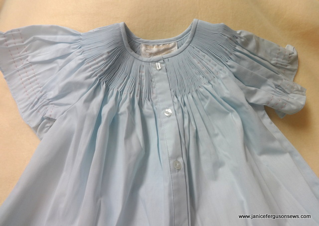 $25 + postage, insurance at buyer's discretion.  Size 12 months blue button front bishop, ready to smock.  Two available.