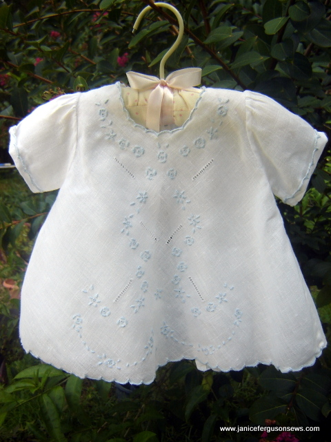 SOLD #18 Linen Diaper Shirt with Blue Embroidery, $20 + shipping. Every stitch done by hand, including the cutwork scallops, all embroidery, drawn thread work and French seams. The utility buttons have been replaced with mother of pearl. This is another purchase from Old San Juan, and it looks sooo sweet on a baby girl.
