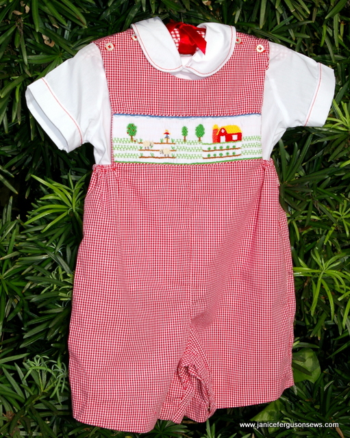 "SOLD #19 Smocked Farmland Romper, $45 + shipping. ""Smockable"" boy's romper, size 3T, which as a blank cost $40 from Martha Pullen Company. It is smocked with Ellen McCarn's Farmland plate. Utility buttons replaced with MOP, shirt collar and cuffs embellished, machine hem removed and stitched by hand--and then never worn. Maybe I made too many clothes for this little guy. More photos and details are posted in Finishing Touches for Alastair's Farm Suit  and  Stitching in the Mountains."