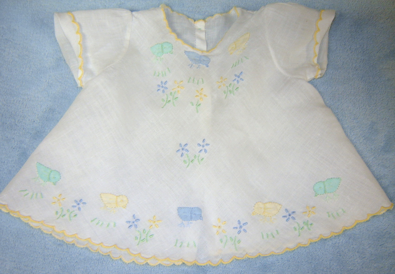 $13 + shipping.  Linen diaper shirt with Madeira applique chicks.  Made entirely by hand, including hand stiched scallops.  Utility buttons have been replaced with MOP.  For details and history, click here.
