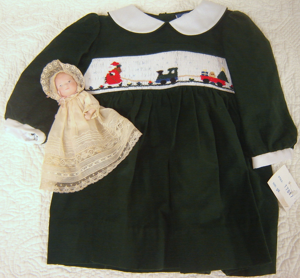 #21 Girl's smocked Christmas Dress, 6 months, $25. New, never worn, forest green featherwale corduroy with picture smocked insert. See matching 12 month girl and 3 month boy outfits below.