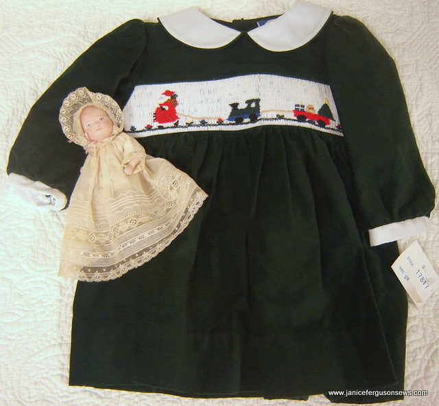 SOLD #21 Girl's Smocked Christmas Dress, 6 months, $25. New, never worn, forest green featherwale corduroy with picture smocked insert. See matching 12 month girl and 3 month boy outfits below. (Doll not included.)