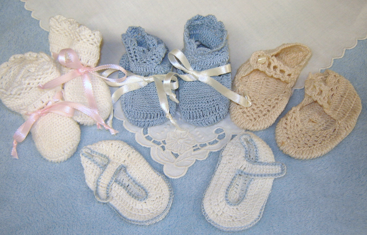 # Crochet Booties from Puerto Rico, $10 each pair. # A White Hightops w/pink ribbon, # B blue hightops, # C ecru Mary Janes, #D white w/blue Mary Janes
