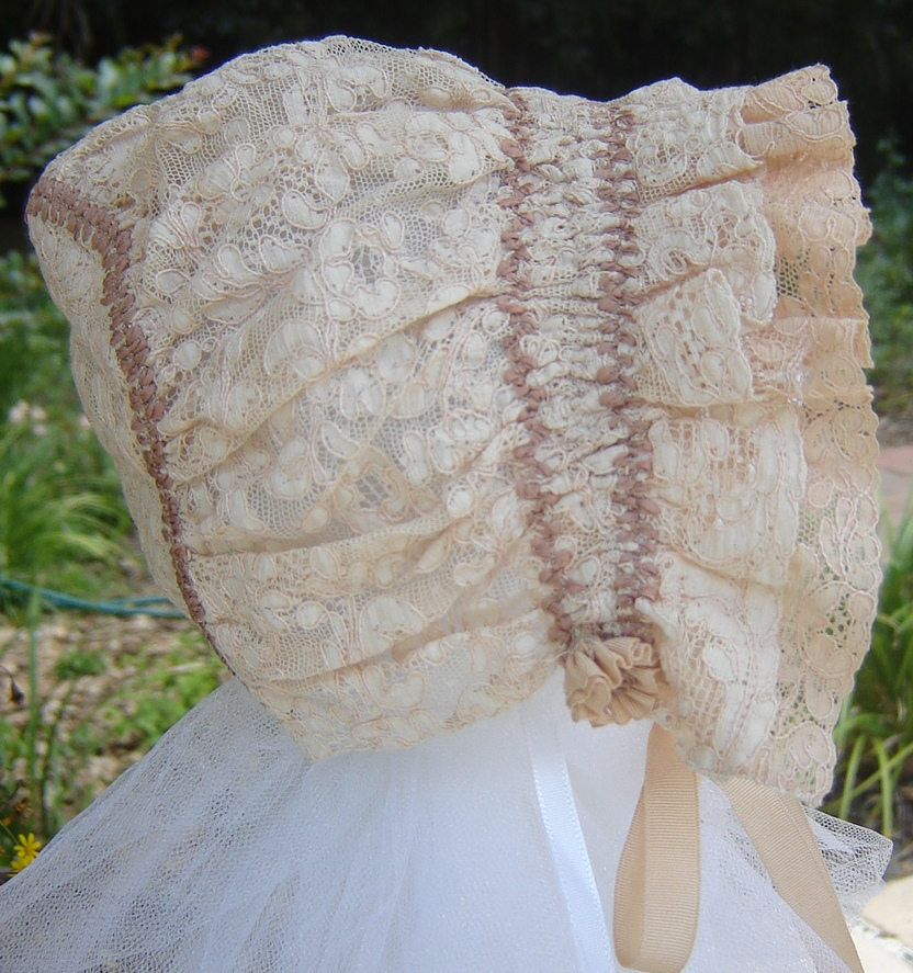 #75 Antique Lace Ruched Bonnet, $25. Sample made for Creative Needle magazine article. Silk ribbon feather stitching, antique silk grosgrain ribbon. Never worn. For more info, click here.