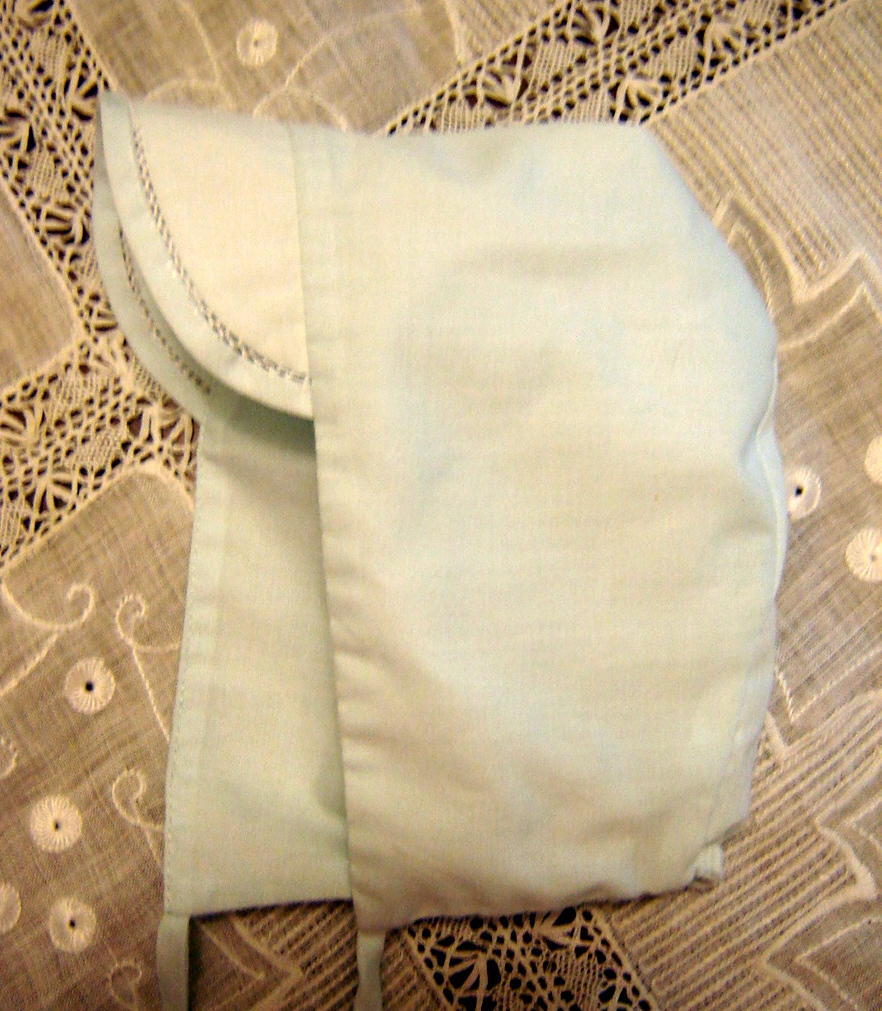 #74 Boy's Cap, 0-3 months, $5. Fully lined, easy care blue batiste with fagoting on brim, $5. New, never worn.