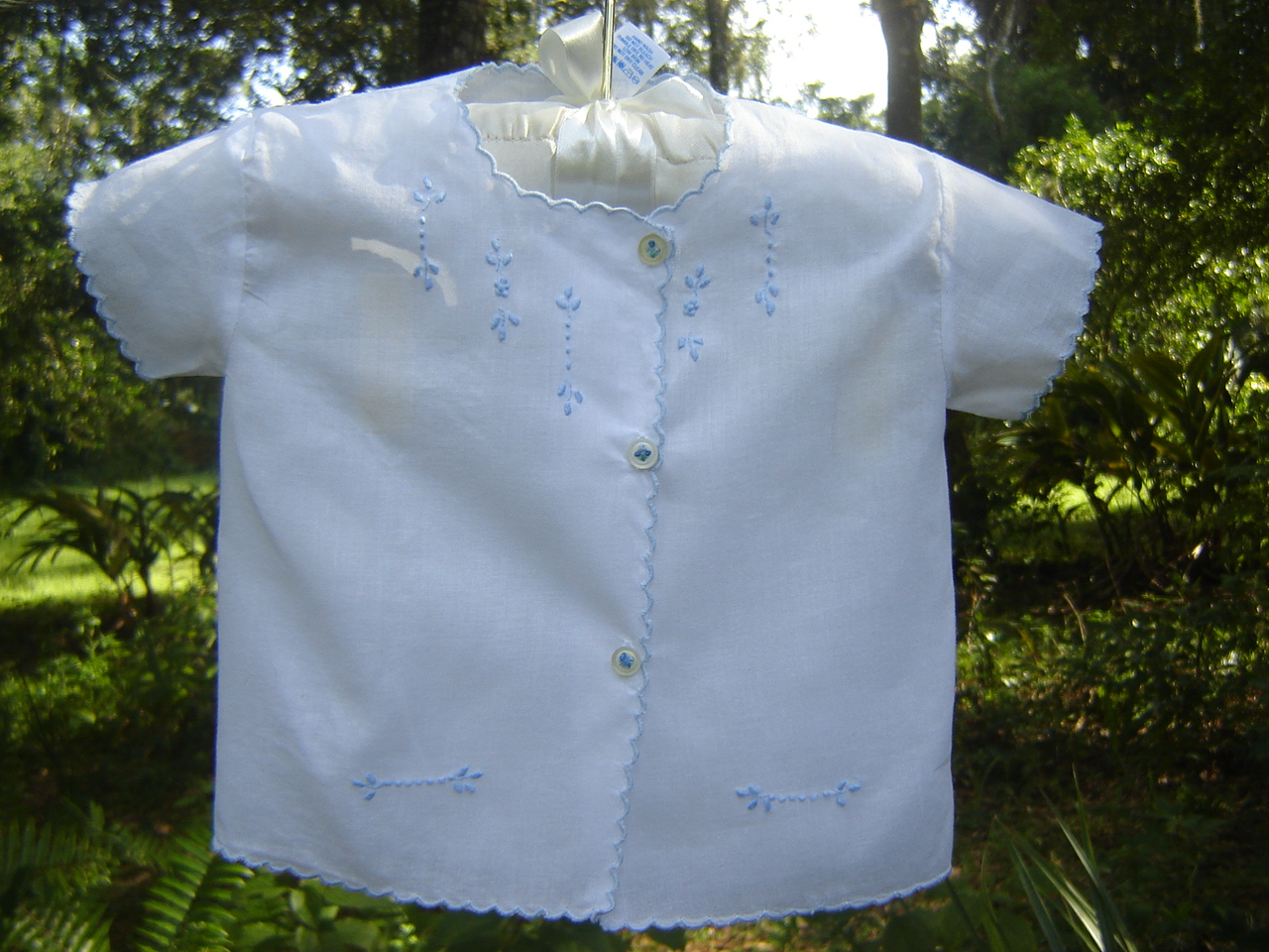 #80 Hand Embroidered Diaper Shirt, 3 months, $10. Easy care fabric, mother-of-pearl buttons, worn a few times but in perfect condition. More photos and info are posted here.