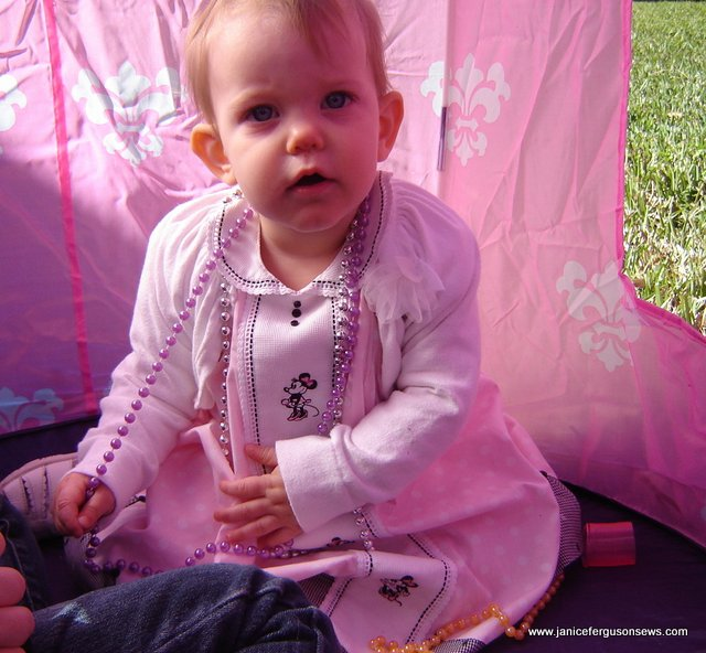 The birthday girl holding court in her Minnie tent.