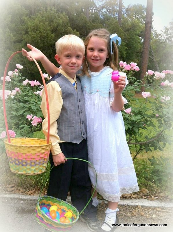 This was a few Easters ago, in front of the pink knockout roses.  Which reminds me........I MUST get started on Easter outfits.