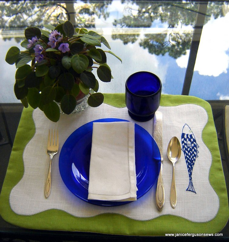 The embroidery and gingham made this a more casual setting than the hemstitched linen napkins shown here.