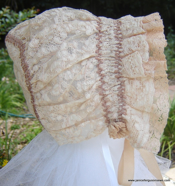 #   ----$25, infant size.  Antique lace bonnet ruched and with antique silk grosgrain ribbon ties. Double ruffle.  One of my favorites, never worn.