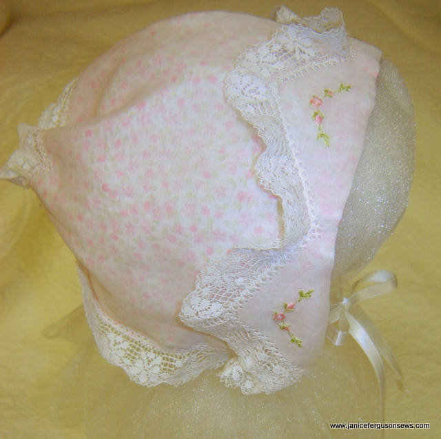 #95--$25 infant Swiss Organdy Zig Zag Bonnet, $25. Lined with tiny floral print lawn, edged with hemstitched heirloom lace, machine embroidery on brim. Made for class sample. More about this bonnet is posted here Zig Zag Bonnet II.