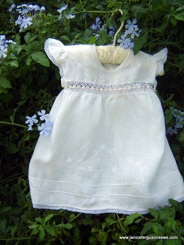 #97---$13, size 6-12 mo. Linen with hand embroidery, purchased in Puerto Rico but remade with addition of tatting.  Read more about it here.