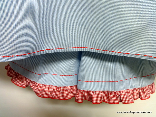 The shirt tail hem is stitched in place with a bean stitch.