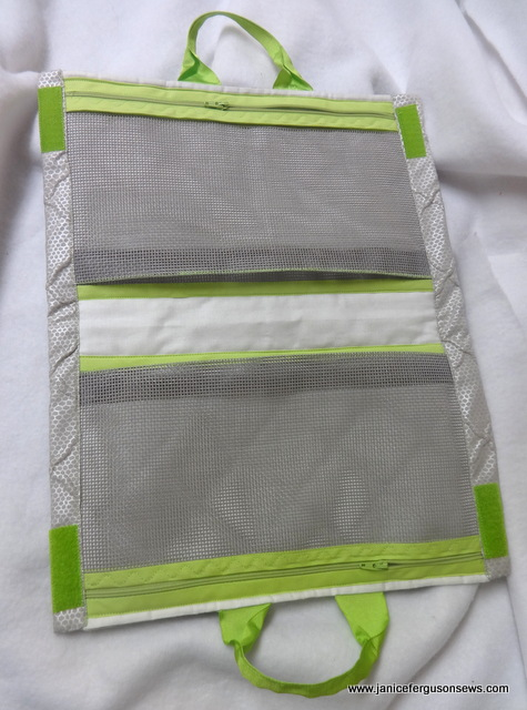 Notice the pleat at the bottom of each screening bag. The free edge has been zig zagged with lime green thread to secure the crease and to add another touch of lime.    color.