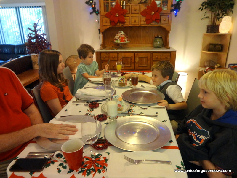 all four grandchildren at the kids' table, waiting for their plates