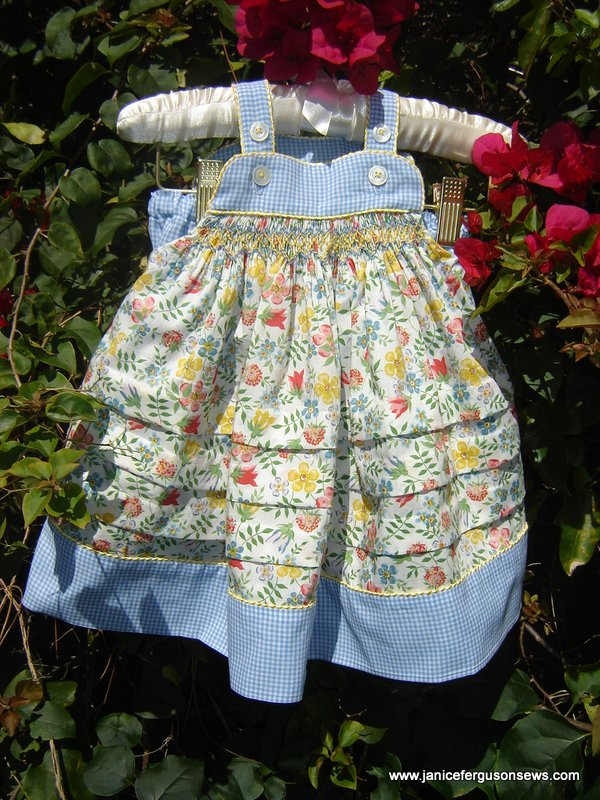 """$20 for 2-piece Liberty tana lawn sundress, size 18 months, Children's Corner """"Katina."""" Three large growth tucks could extend the dress's length of wear. Ruffle bottom bloomers complete the outfit."""