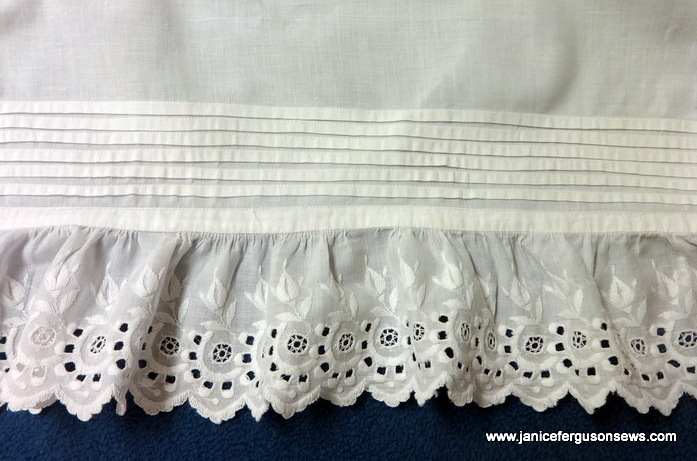 "6 tucks and beautiful Swiss embroidered edging on 35"" slip"