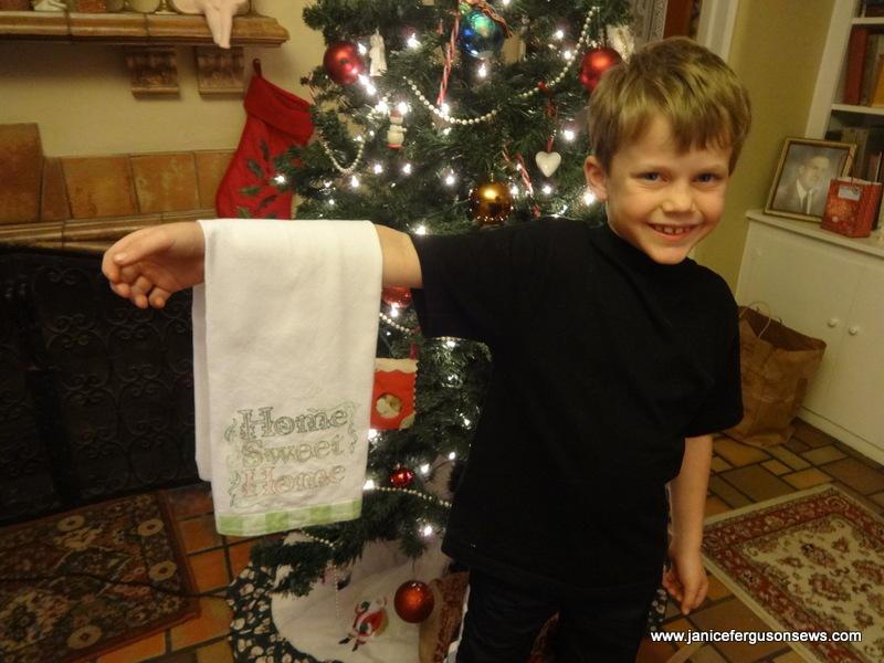 Alastair with the dishtowel he embroidered for his mother.